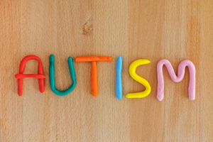 "Colorful clay spelling out the word ""Autism"""