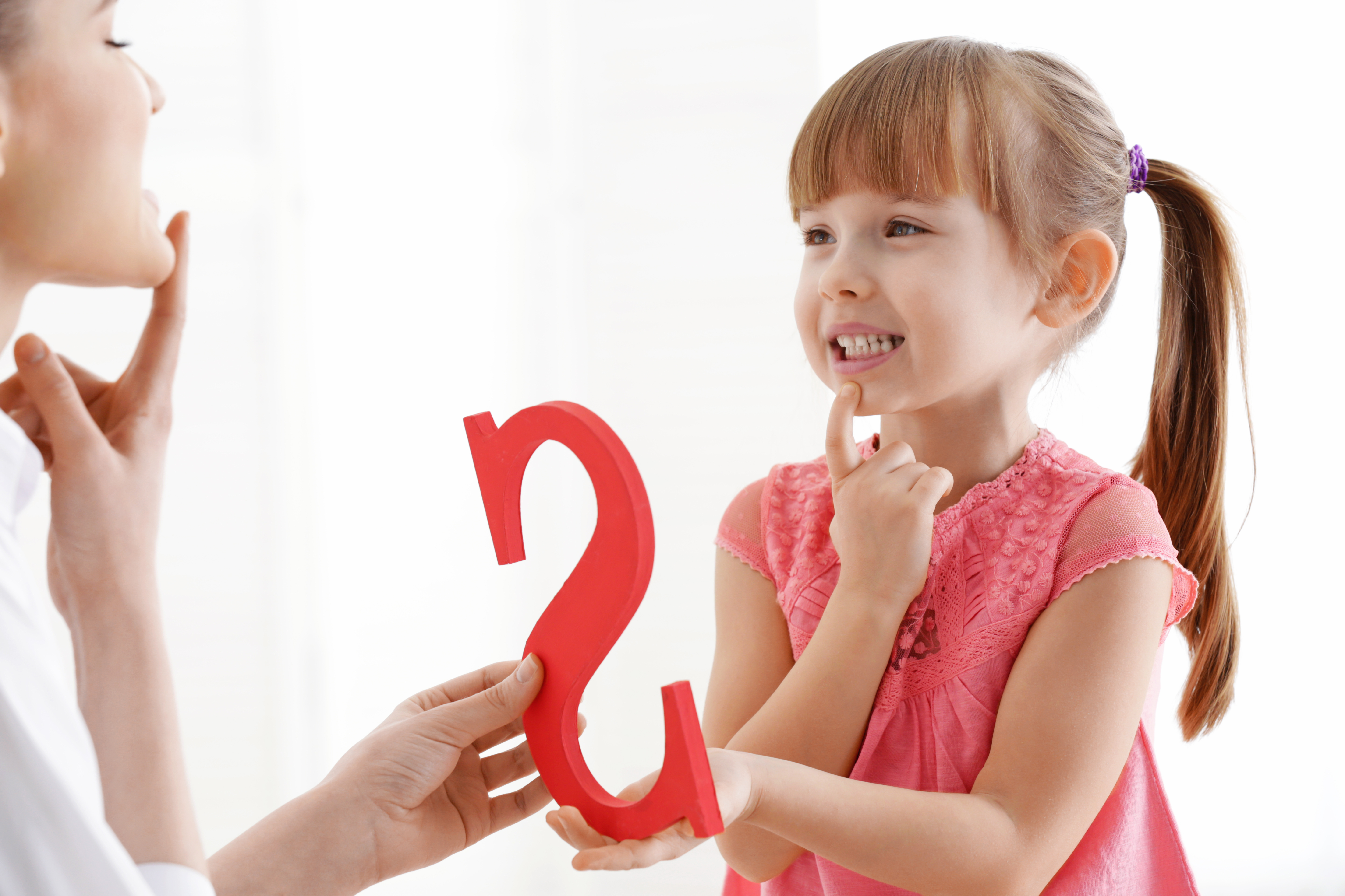"A Child Learns How To Communicate The Letter ""S"" Through Speech Therapy"