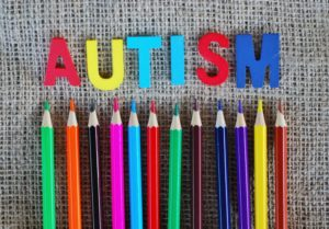 "Colored Pencils Pointing To Letters Spelling Out ""Autism"""