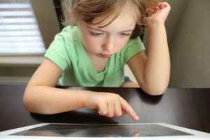 Child with nonverbal autism using an AAC